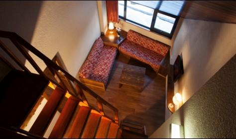 Habitación Duplex. Salon Con dos camas individuales